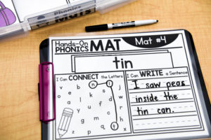 A filled out Hands On Mats phonics sheet