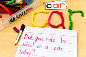 "Here, a student ""wrote"" the word ""car"" with pipe cleaners, and then wrote a sentence with that word on an index card."