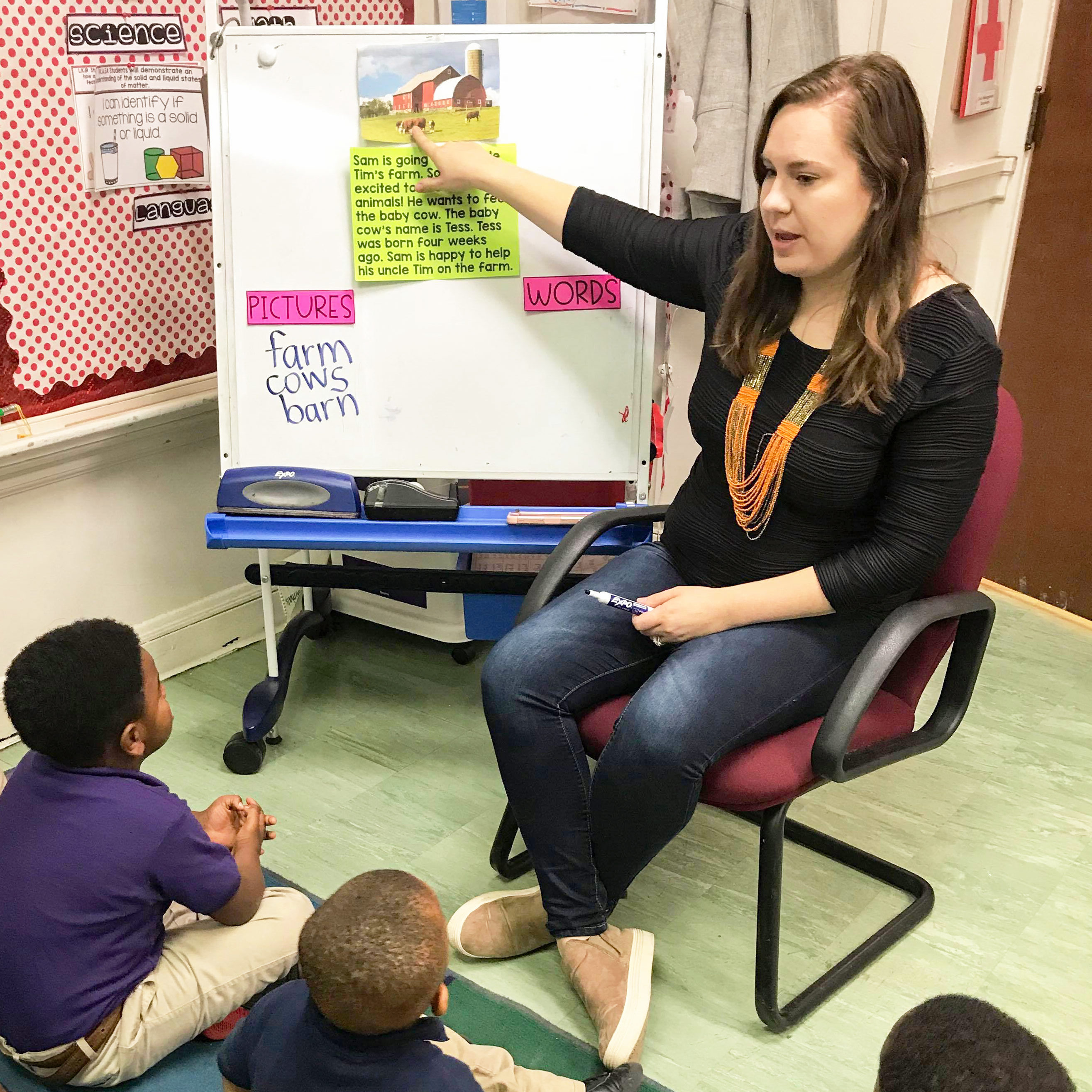 Kindergarten teacher Anna Kazandjian pointing to a whiteboard.