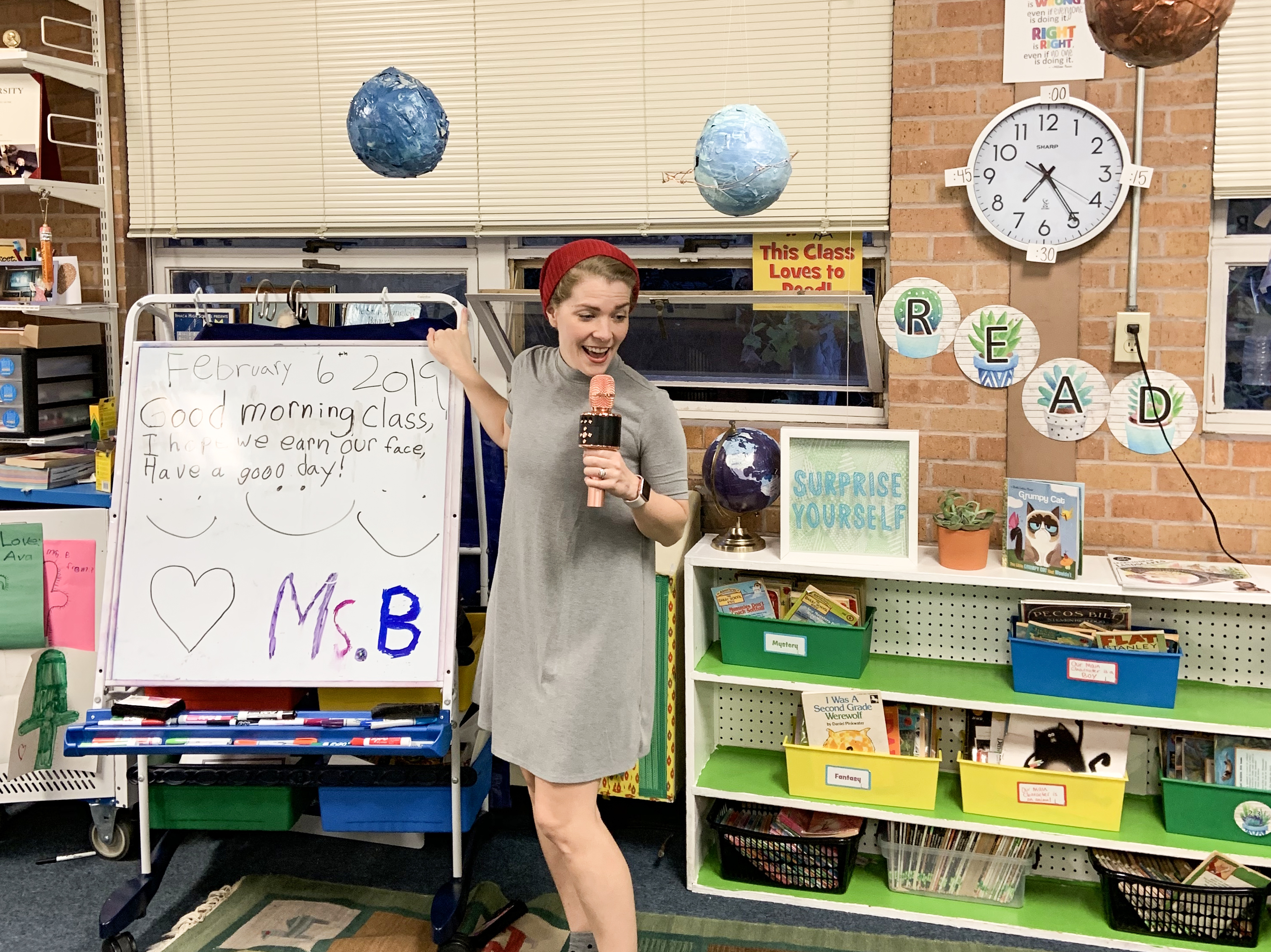 2nd grade teacher Hannah Burkhauser standing in front of a whiteboard easel.