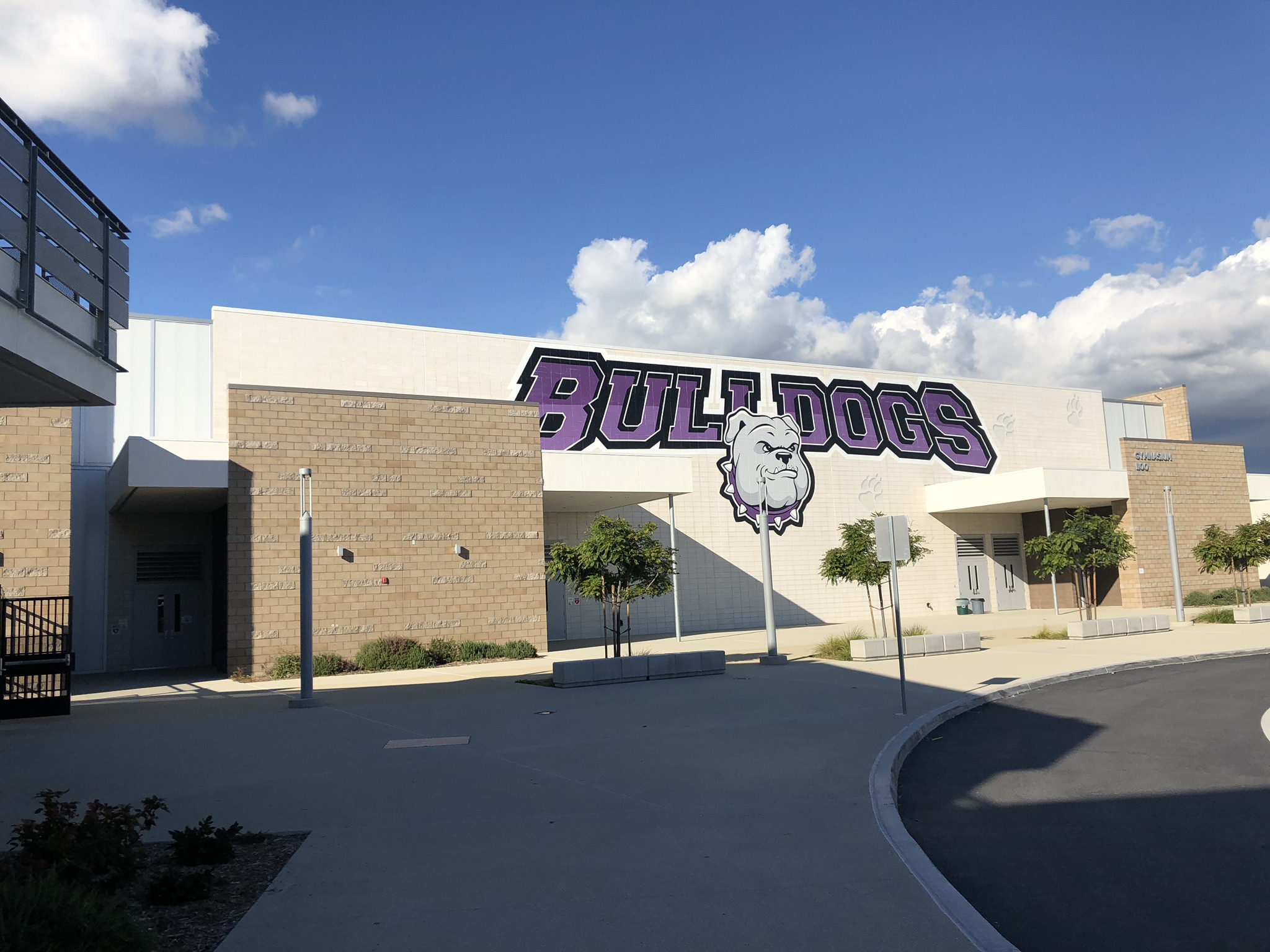 "A mural on the front of Portola High School that reads ""Bulldogs."""